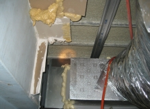 Asbestos containing vermiculite above a plasterboard ceiling