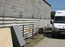 Galbestos sheeting being used as fencing