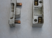 Woven Asbestos fuse lining inside fuse holder on right
